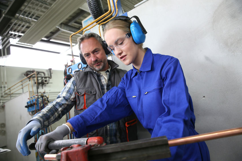 apprentice with mentor in workshop