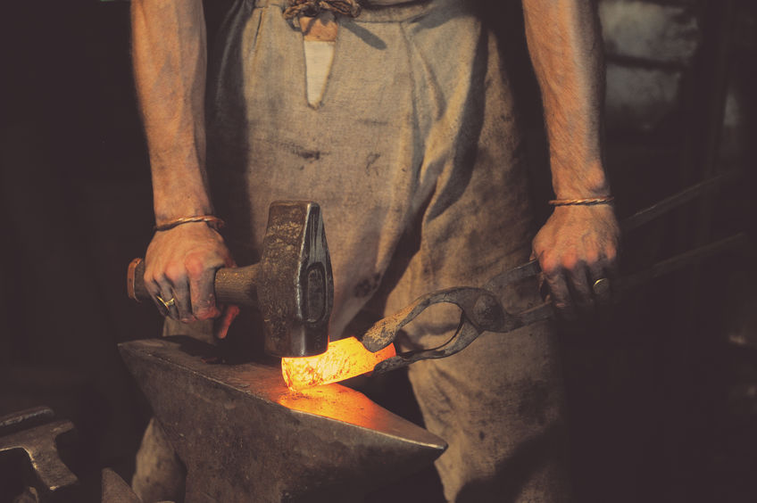 blacksmith working at an anvil